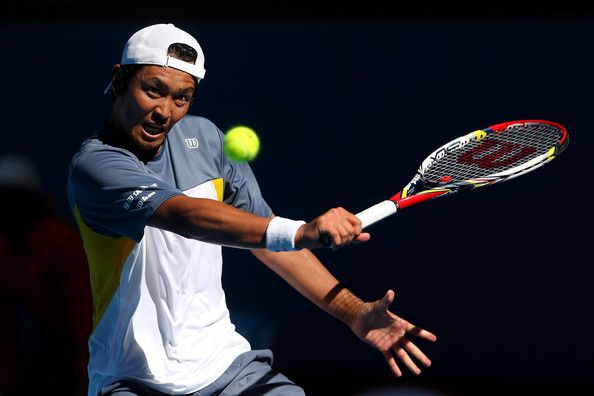Tatsuma Ito of Japan plays a backhand in his second round match against Marcos Baghdatis of Cyprus during day three of the 2013 Australian Open at Melbourne Park on January 16, 2013 in Melbourne, Australia.