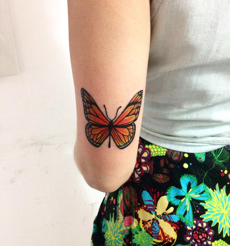 butterfly tattoo on back of arm