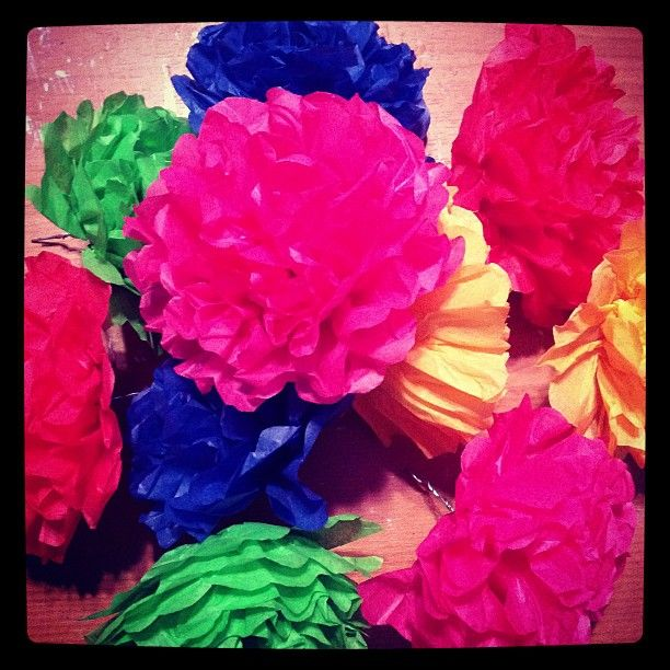 I'm in the middle of of drying some paper mache masks. As I wait for them to dry I'm working on a stack of tissue paper flowers that I pl...