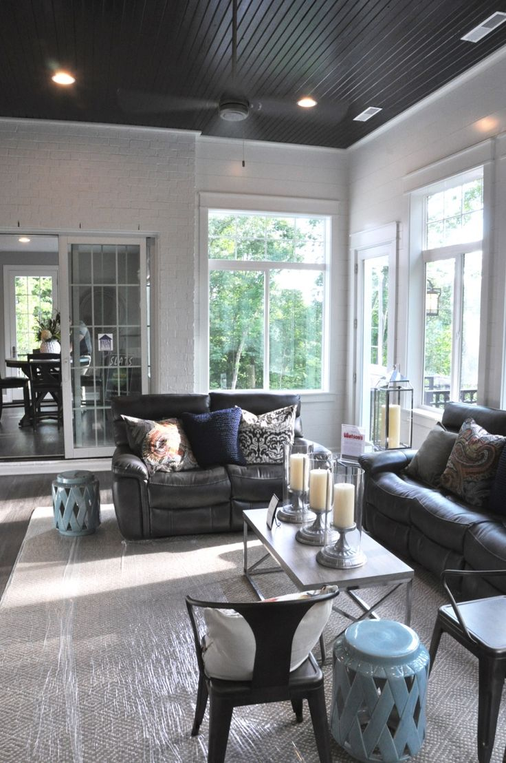 Inspiration for a mid sized timeless enclosed living room remodel in - Enclosed Porch Painted Ceilings