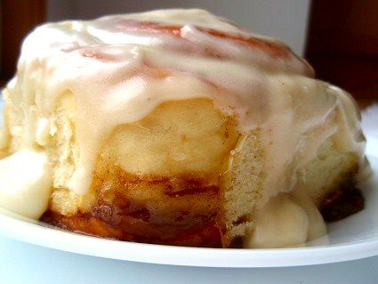 A fluffy, soft, chewy cinnamon roll drizzled with cream cheese frosting -- the best cinnamon rolls ever! This recipe makes a knock-off version of Cinnabon's cinnamon rolls!