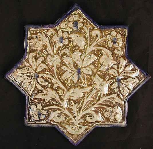 Tile  Date:early 14th century  Geography:Iran  Culture:Islamic  Medium:Stonepaste; glazed and luster-painted  Dimensions:8 1/4 in. (21 cm)  Classification:Ceramics-Tiles  Credit Line:Fletcher Fund, 1975  Accession Number:1975.117.1