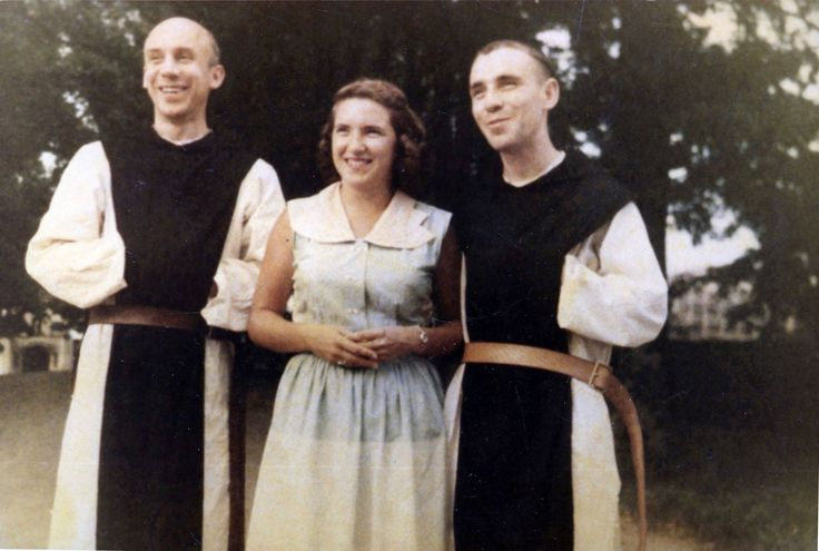 Fr. Louis-Thomas Merton OCSO and Fr. John of the Cross Wasserman OCSO as young monks at the Abbey of Gethsemani with Fr. John of the Cross' sister in the center who became a Discalced Carmelite Nun