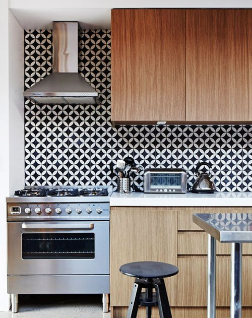 Graphic tiles as kitchen backsplash