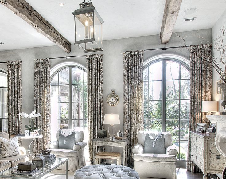 the arch window is come with a length- floor curtain that comes with similar tone as the lighting furniture. The motif of the curtain also give a more aristocrat look to the room.