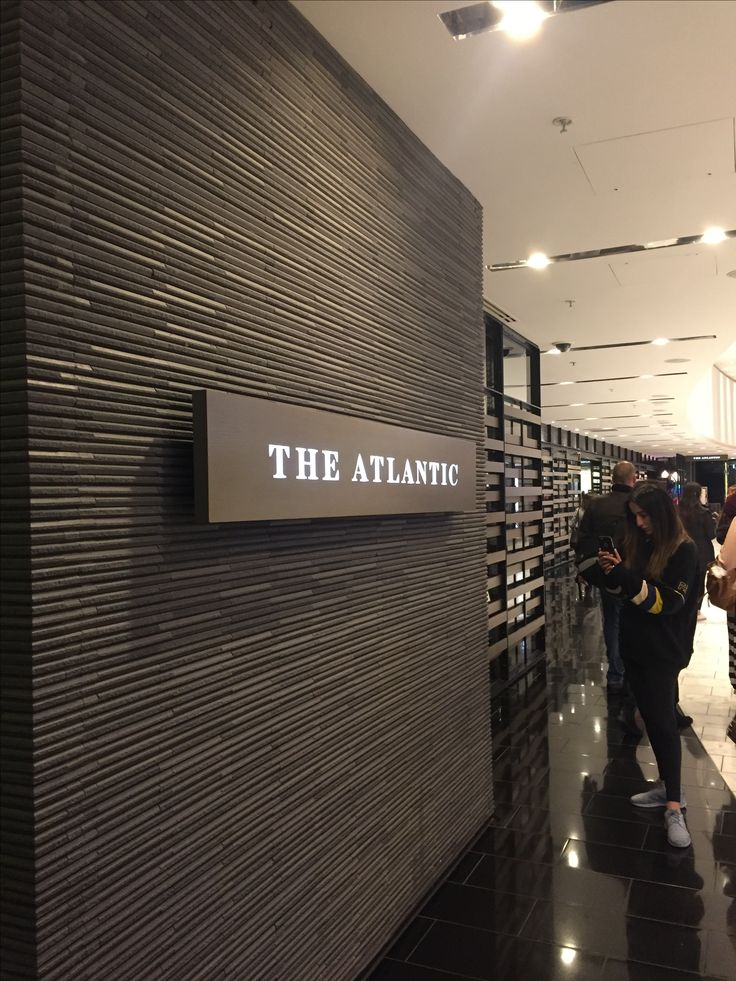 Photo 5: Using narrow porcelain or stone tiles the curved entrance to The Atlantic restaurant at Crown is clearly defined. The charcoal tiles give a feeling of permanence, dependability and strength.