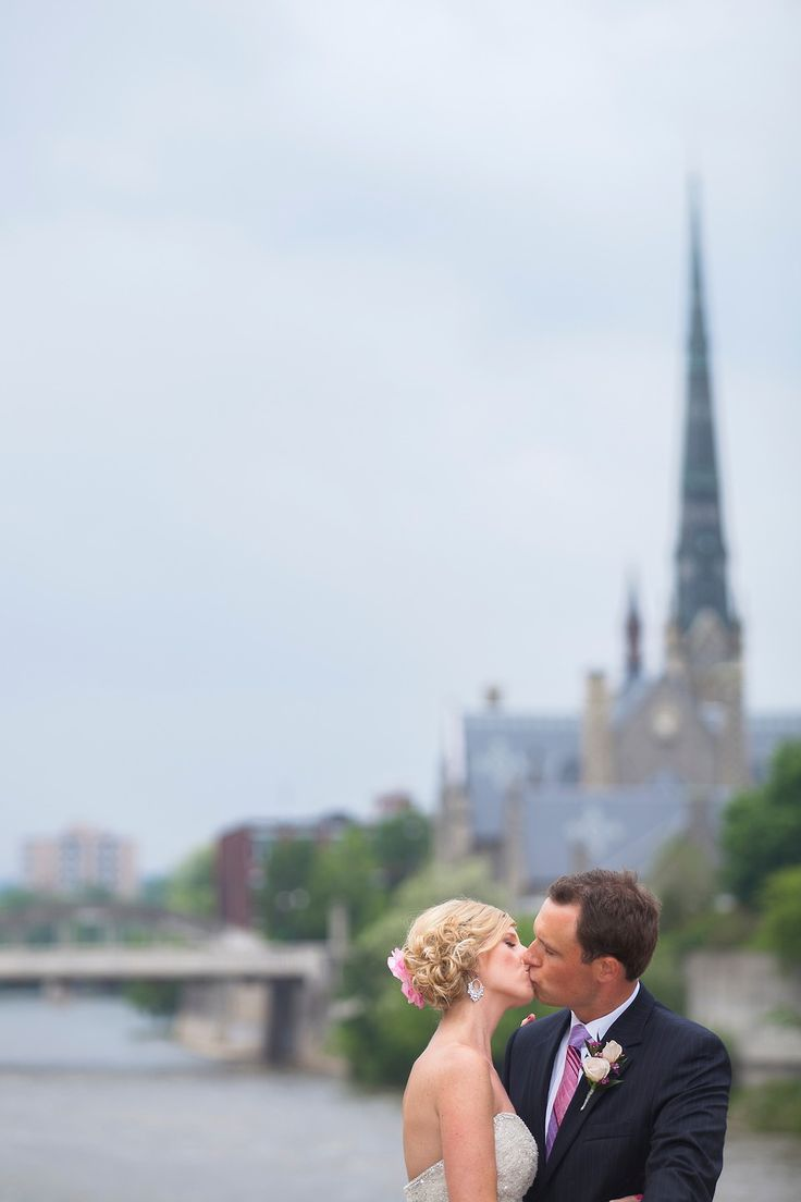 pink flower, Church background, Grand River, River background, Curled updo, Pink tie, Cambridge Mill, Cambridge, Ontario, Canada wedding photography experts | Anne Edgar Photography