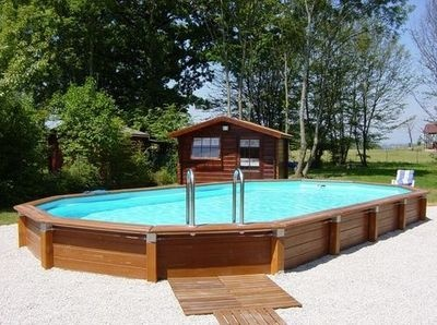 Above ground pool surround idea partially buried in for Swimming pool surrounds design