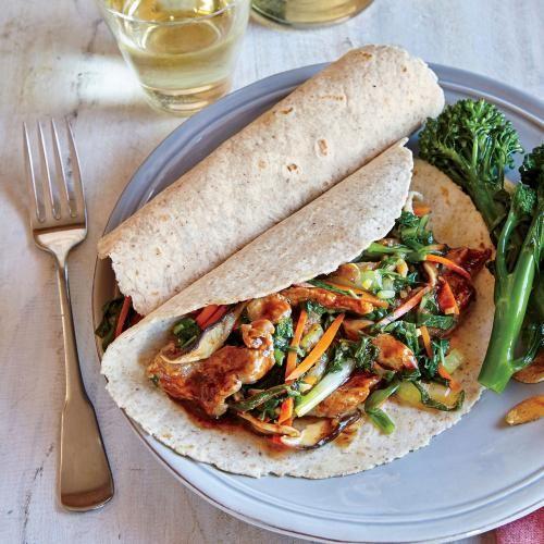 Mu Shu Pork Wraps | Chinese restaurants serve mu shu pork with Mandarin pancakes. On a busy weeknight, whole-wheat tortillas are an easy sub. | Cooking Light