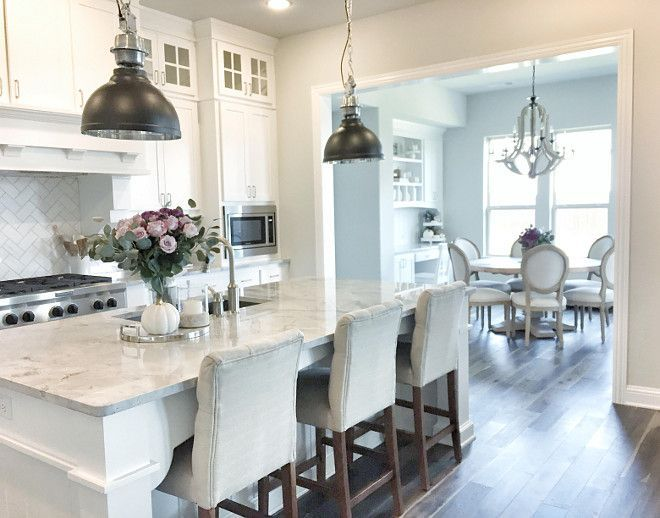 White cabinet paint color is Sherwin Williams Pure White. Light grey wall paint color is Sherwin Williams SW 7015 Repose Gray.
