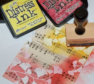 White embossing powder - inked over on vintage sheet music, a Distress Ink Tutorial.