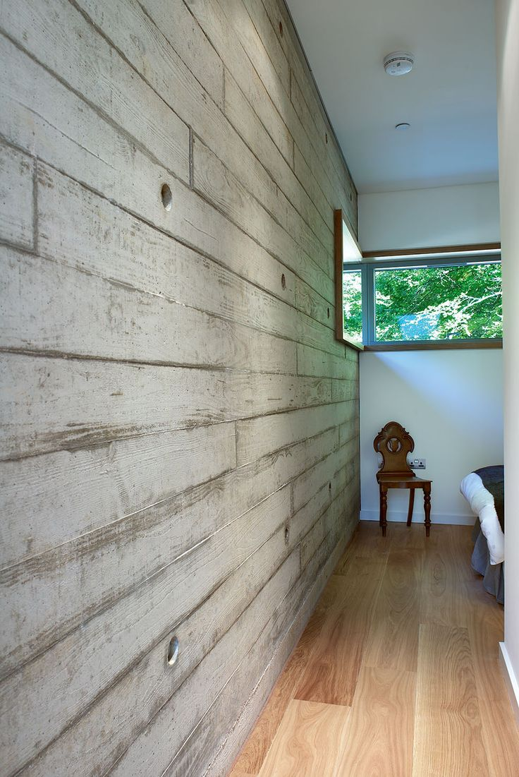 shuttered concrete wall with wood grain imprint