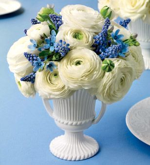Brides.com: Wedding Style Inspired by Wedgwood. Keep the look classical with a white fluted urn. Ranunculus, tweedia, and muscari arrangement, from $150, LMD Floral; lmdfloral.com. Grecian urn, $2.65, Bill's Flower Market; billsflowersmarket.com.