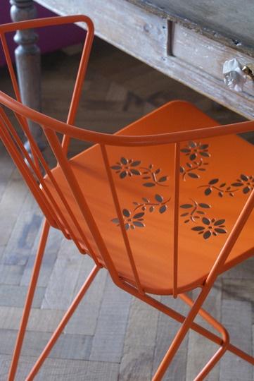 orange chair and white rose desk knob  Reseller: City Escape, 3022 West Lake Street   Chicago IL 60612 Tel: 773-638-2000