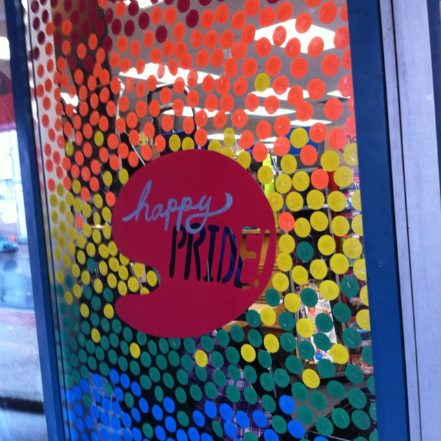 Great window display in Halifax made of simple punched circles, stuck to glass with loops of scotch tape.