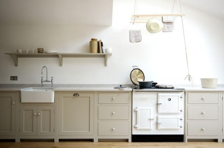 Above: In a Shaker-inspired kitchen in London by DeVol, a pulley-system drying rack (often used in English bathrooms and laundry rooms) provides an over-the-range venue for tea towels and kitchen accessories. See more at A Shaker-Inspired Kitchen in London and Object Lessons: The Sheila Maid Clothes Airer.