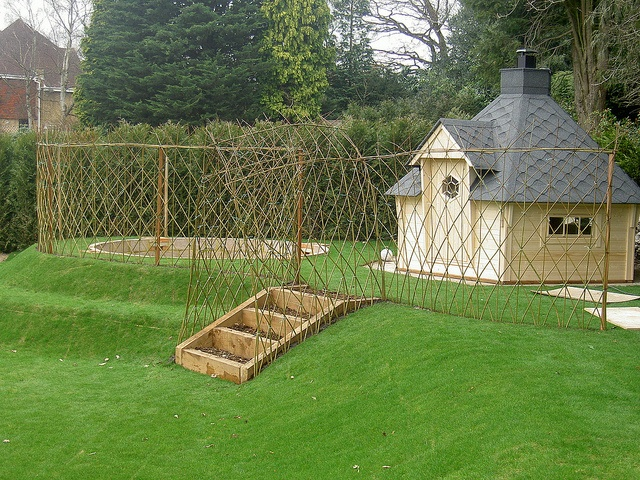 Willow screen for trampoline hobbit hut by garden for Garden hut sale