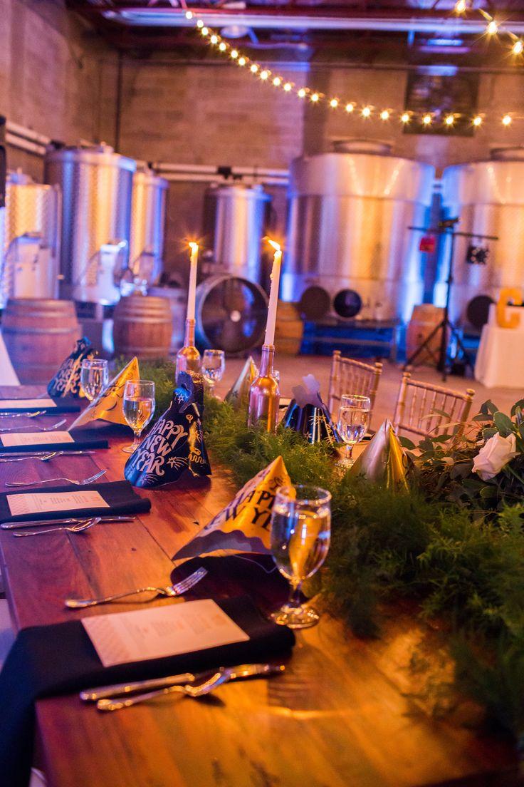 NYE wedding table setting: Gold chiavari chairs, black napkins, & rustic garland runners.  Photography by: Lotus Eyes Photography, Orlando, FL.