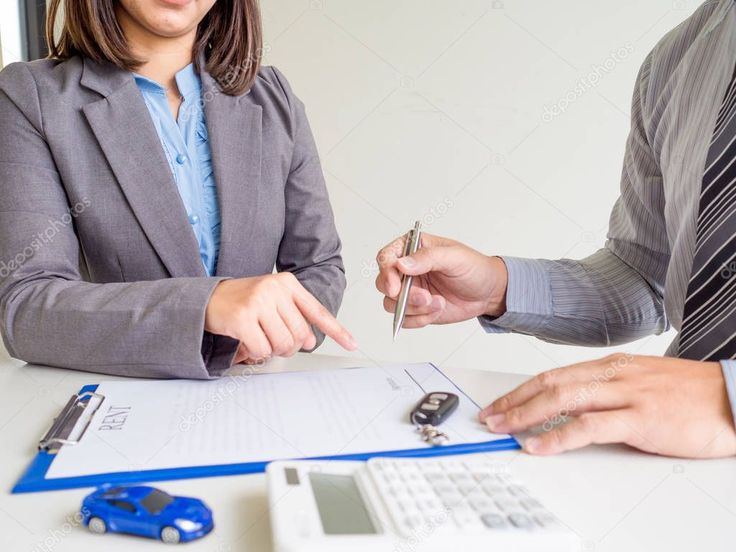 Car saleswoman giving a car rent service lease contract to