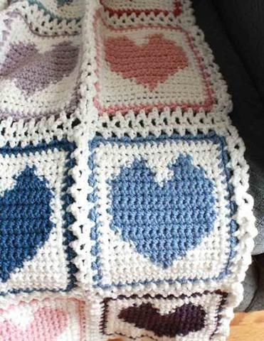 Watch us review this super cute Scrap Hearts Afghan! Design by: Maggie Weldon Skill Level: Intermediate Size: 42″ wide x 64″ long; Materials: Yarn Needle; Worsted Weight Yarn; White (MC): 28 oz, 1680