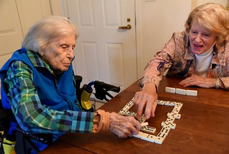 Lois Arbanas, who turns 110 on Dec. 1, plays dominoes at her Arlington Heights home with her daughter, Anne Feichter of Elk Grove Village. Arbanas credits her longevity to exercise and eating right.