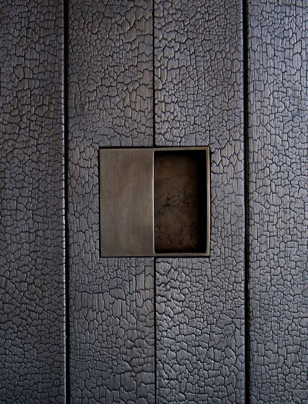 Blowtorch wood (shou-sugi-ban) + brass door handle - Tucson Mountain Retreat. Photo: DUST.