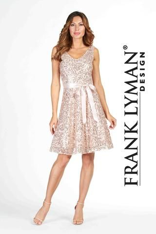 Frank Lyman 2017. Stunning cocktail dress with satin belt and crinoline lining. Proudly Made in Canada