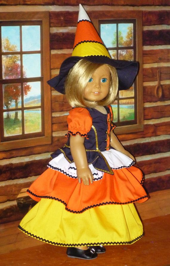 A fun witch costume for Halloween, celebrating the iconic Halloween Treat, Candy Corn. The costume is made from orange, yellow, white and black cotton.