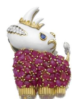 A diamond, ruby, sapphire, gold and white enamel Rhinoceros brooch by David Webb.