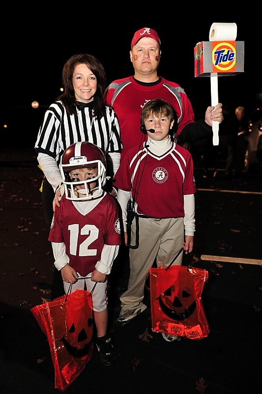 Our Halloween costumes for 2010.  I was a referee, my husband was a Bama fan, my older son was Nick Saban, and my younger son was an Alabama football player.