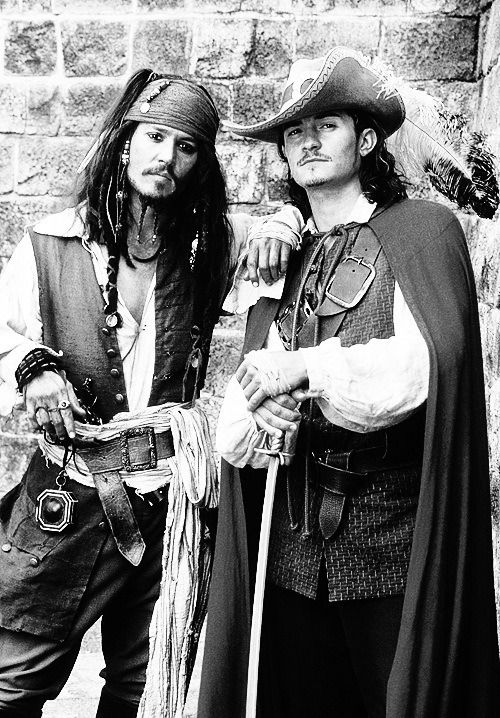 Johnny Depp and Orlando Bloom. oh wait johnny depp is in this picture too? i didn't notice. i was blinded by orlando's glory.