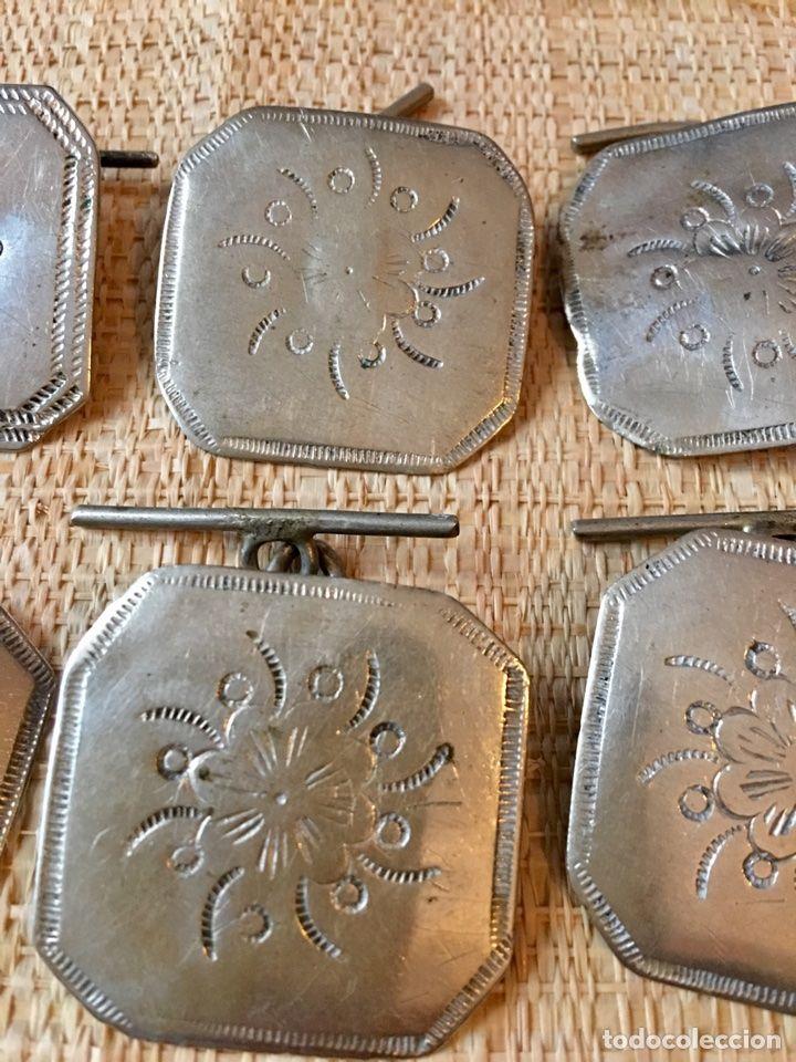 Botones de plata vintage surfista