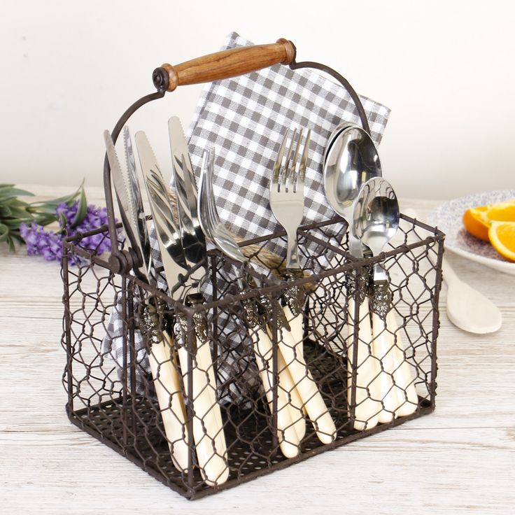 This charming rustic farmhouse cutlery holder is made from chicken wire and features four storage compartments for knives, forks, spoons and kitchen utensils along with an easy grip wooden handle and a perforated base. An ideal country kitchen accessory this cutlery caddy is finished in an authentic antique brown shade and can be used to store cutlery and utensils on a kitchen worktop, transporting cutlery to and from the table.