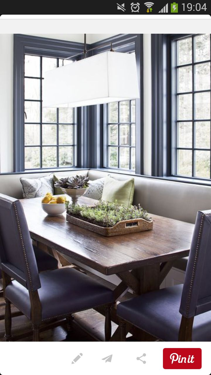 breakfast room with banquette the custom l shaped banquette double as window seat notice the trestle dining table and blue square back dining chairs