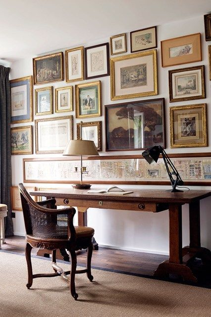 love the mismatched frames... In the study of art dealer Patrick Perrin