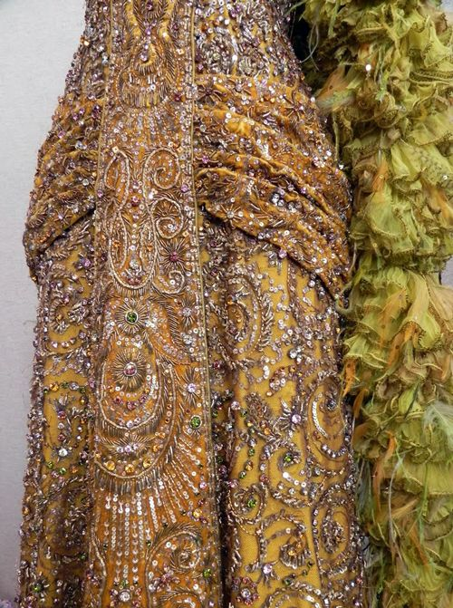 "Sharaff confirmed that in her 1968 interview when she stated, ""The thread used in the Hello, Dolly! dress is made of pure gold. It comes in very fine tubes, is pliable and can be threaded like beads. Because of some technical lighting problems, the pure-gold material was the only way I could achieve the quality that both the director and I wanted."""