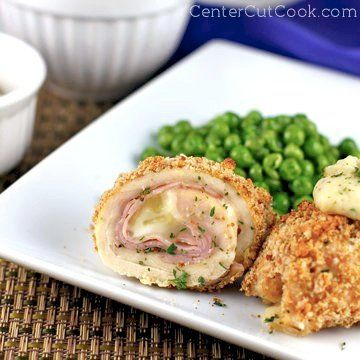 Thin slices of chicken, ham, and cheese are rolled up, covered in bread crumbs, and baked until crisp, then topped with a homemade parmesan pepper sauce. We call them Chicken Cordon Bleu Rollups and they are absolutely delicious!
