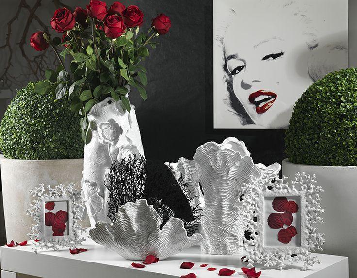 Vasi resina portafoto, fiori e piante artificiali.