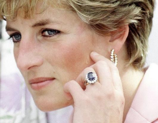 """Princess Diana: Princess Diana chose her own ring from Garrard Jewelers when Prince Charles proposed to her. There are a couple of different theories on why Diana selected her 18-carat oval sapphire surrounded by 14 diamonds: the color matched her eyes, the Queen may have actually selected it, or as Diana was later quoted as saying, """"It was the biggest."""" Who's to say what the real reason is?"""