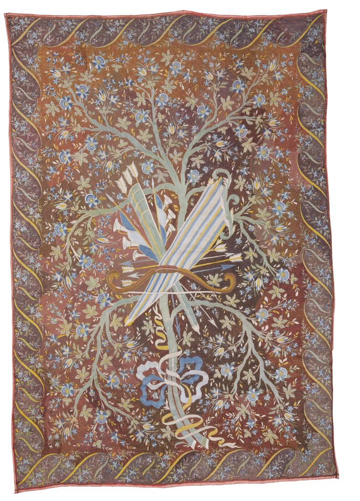 Embroidered coverlet, Ottoman  worked with central ribbon tied group of trophies including quiver and bow and musical instruments, with a scrolling ribbon and flowering trail border, on a burgundy ground  Approximately 221 by 150cm., 7ft. 3in., 4ft. 11in.  first half 19th century