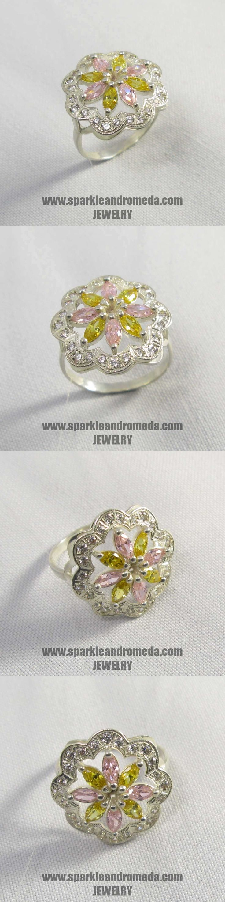 Sterling 925 silver ring with 4 marquise 5×2,5 mm pink morganite color 4 marquise 5×2,5 mm golden beryl color and 16 round 1,25 mm white color cubic zirconia gemstones.