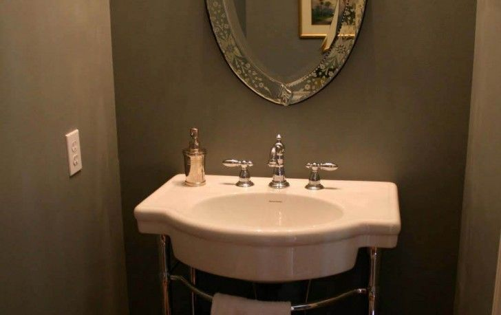 Extraordinary Small Bathroom Design With Elegant Oval Mirror On The Gray Wall With Minimalist Washstand Interior Design Furniture Represents Your Personality Furniture