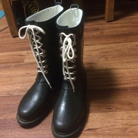 Ilse Jacobson designer rain boots Worn several times, but show few signs of wear. Size eu 38, but I think they'd fit best for an 8 or 8.5. Feel free to make an offer! Shoes Winter & Rain Boots