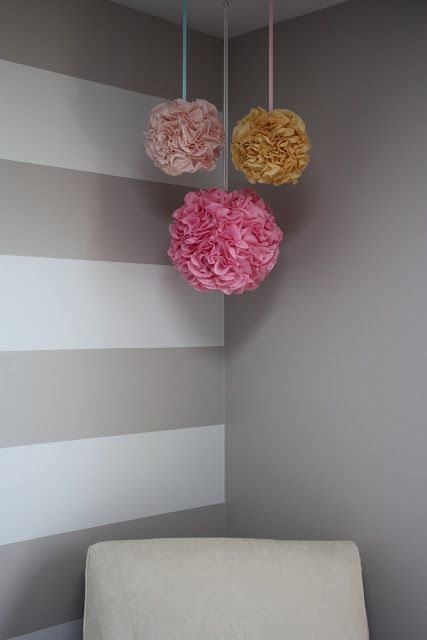 DIY Pom Poms. For a cheaper version try with styrofoam balls and tissue paper