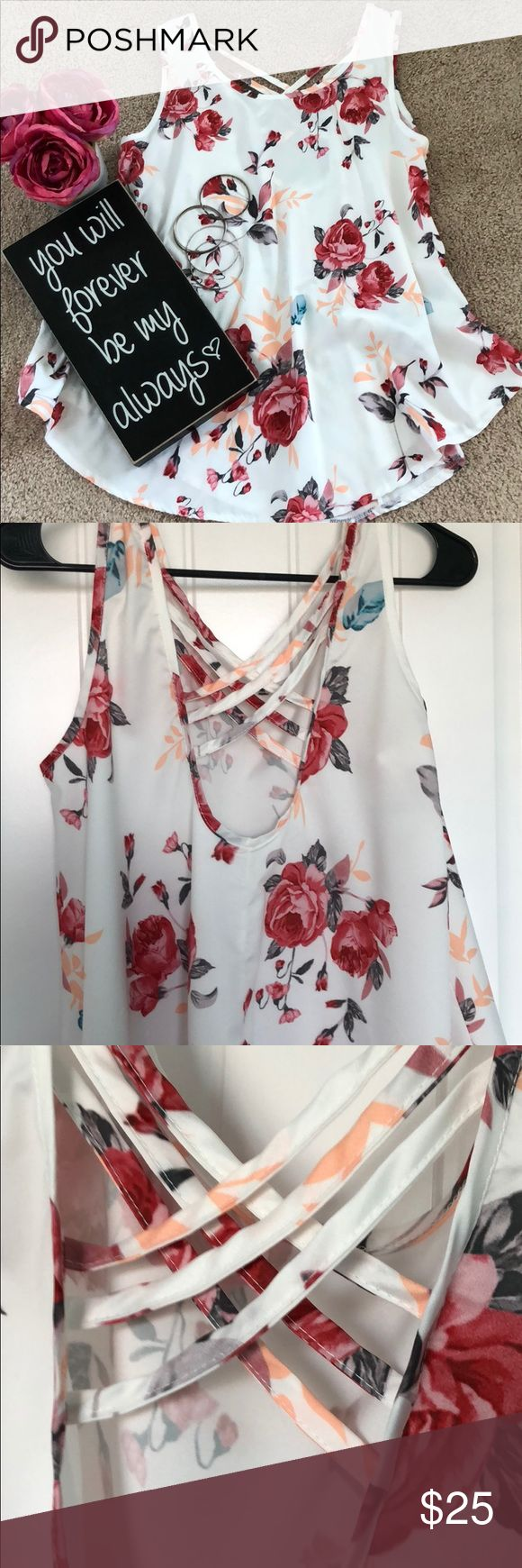 """Floral flowey tank w/crisscross straps on back Floral flowey tank w/crisscross straps on back. Brand new. Never worn. Never washed.  There is no tag on this item. (I know odd),  bust measurement is 20"""". Armpit to hem 20"""".  Based on measurements and cut of shirt I'm gonna day size Large. This s top does curve up on the side hem to 15"""". Look at last pic.  Love the on trend floral design! Browse my jewelry and find something to wear with this! Tops Blouses"""