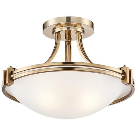 White glass beautifully completes this warm brass semi-flushmount ceiling light.