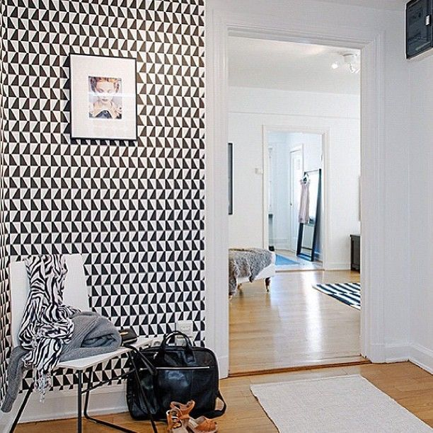 Arne Jacobsen Borastapeter Wallpaper Trapez, looking dramatic in black and white. Geometric lines really define this area in the home, all grounded with the plain furniture and walls so it doesn't over power the space  (scheduled via http://www.tailwindapp.com?utm_source=pinterest&utm_medium=twpin&utm_content=post196796411&utm_campaign=scheduler_attribution)