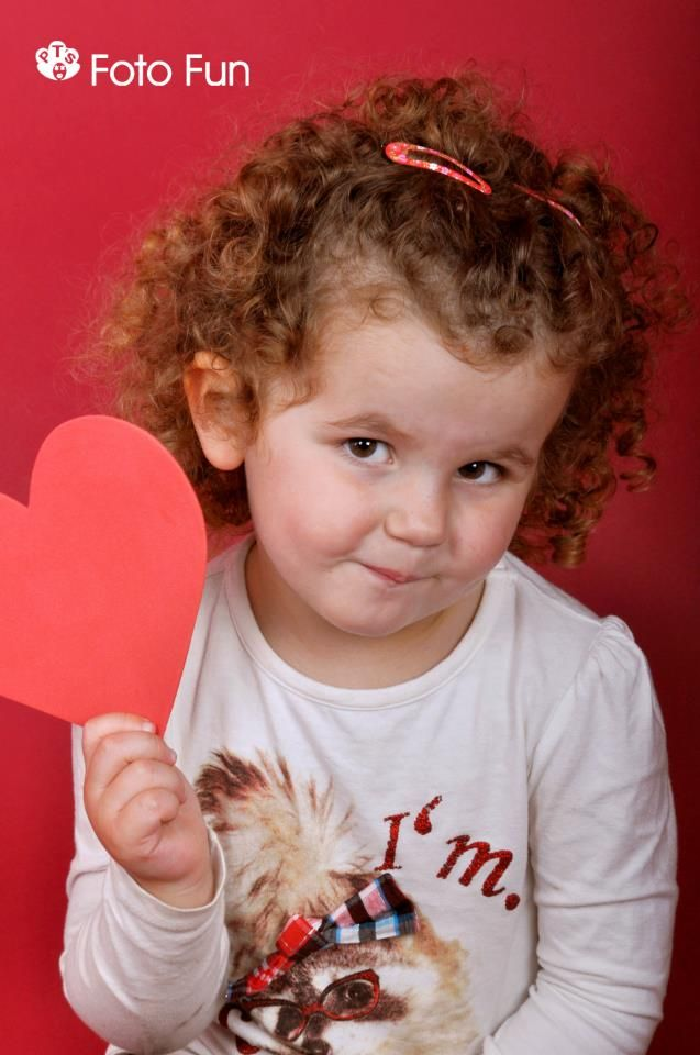 cute curly haired girl with heart
