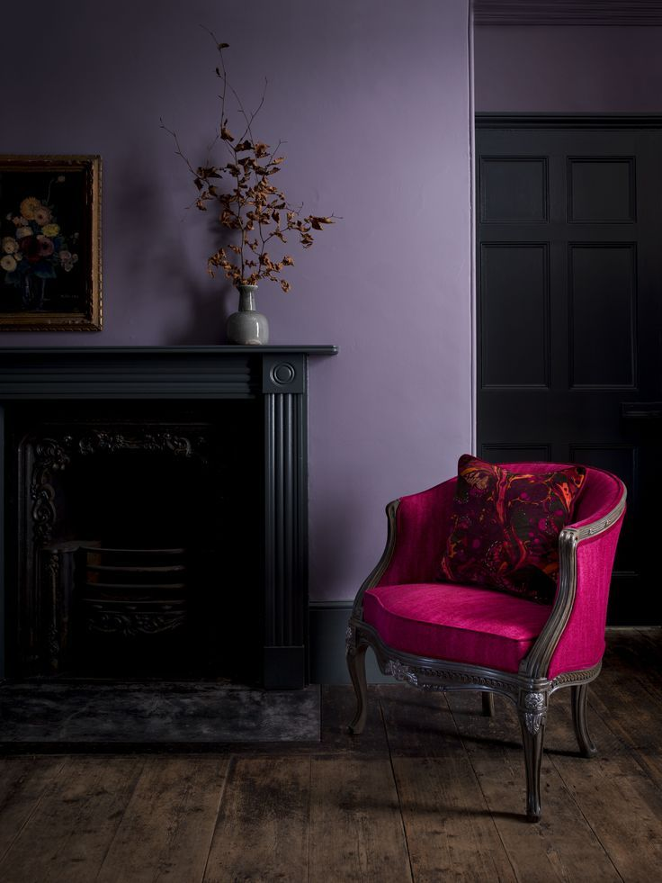 Introducing Matthew Williamson's first ever bespoke furniture collection. Created in collaboration with Nottingham-based sofa manufacturer Duresta, the designs comprise five upholstery ranges and unique occasional pieces. A throw pillow featuring the Marble Butterfly print rests on a red velvet armchair. The two stand out against a purple wall and a dark wooden floors.