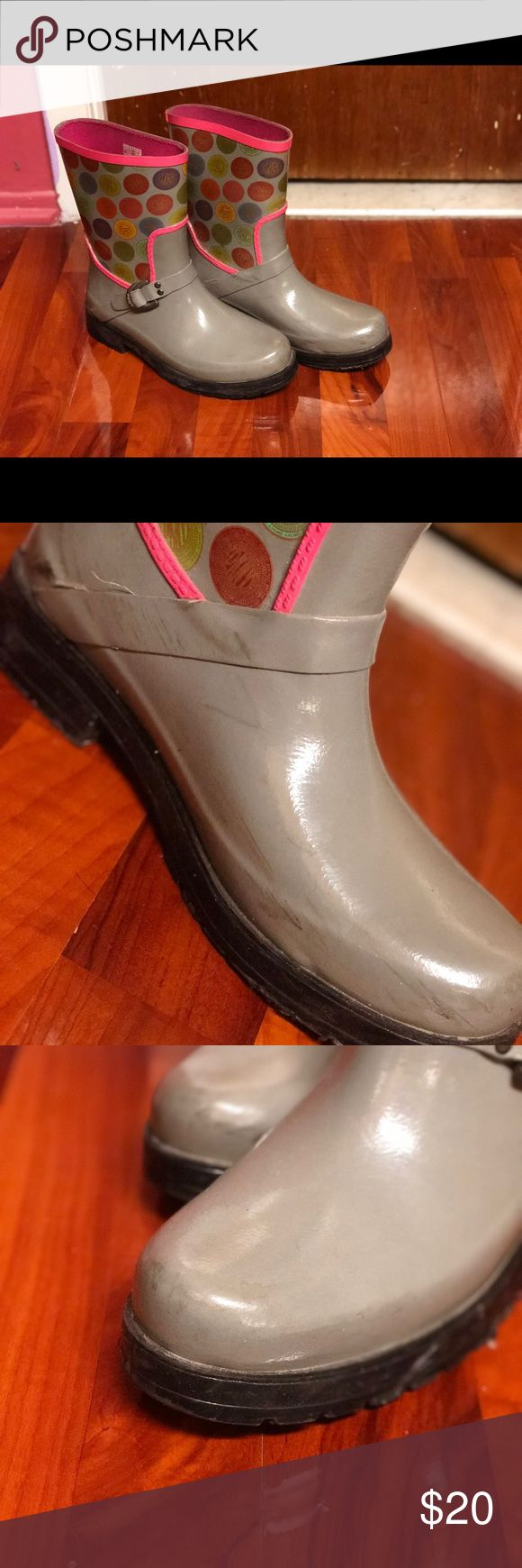 DKNY Rain boots Cute DNKY gray & pink rain boots. These boots have been worn a few times but are EXTREMELY durable & excellent quality. Your feet don't get wet at all in them. I've never worn them in the snow so I won't be able to shed light on that aspect. They have a few scuffs from battling the nitty gritty sheets of NYC, but nothing major. These are listed as a size 8 boot but I wear an 8.5 and they fit perfectly (which means they run big) Dkny Shoes Winter & Rain Boots